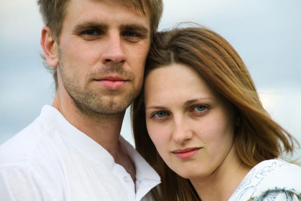 head shot of man and women standing