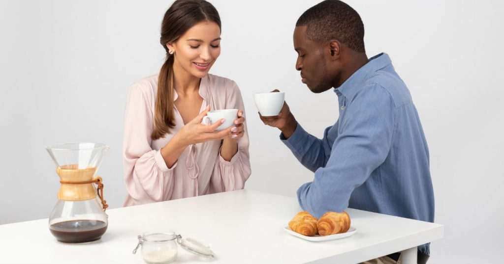 Dating Tips for Shy Guys, aboy and a women on coffee table for a date