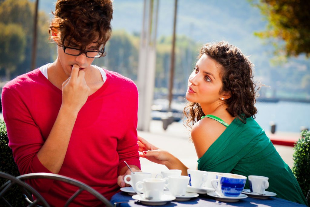Girl and a boy on coffee table for a date