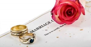 marriage ring and rose flower