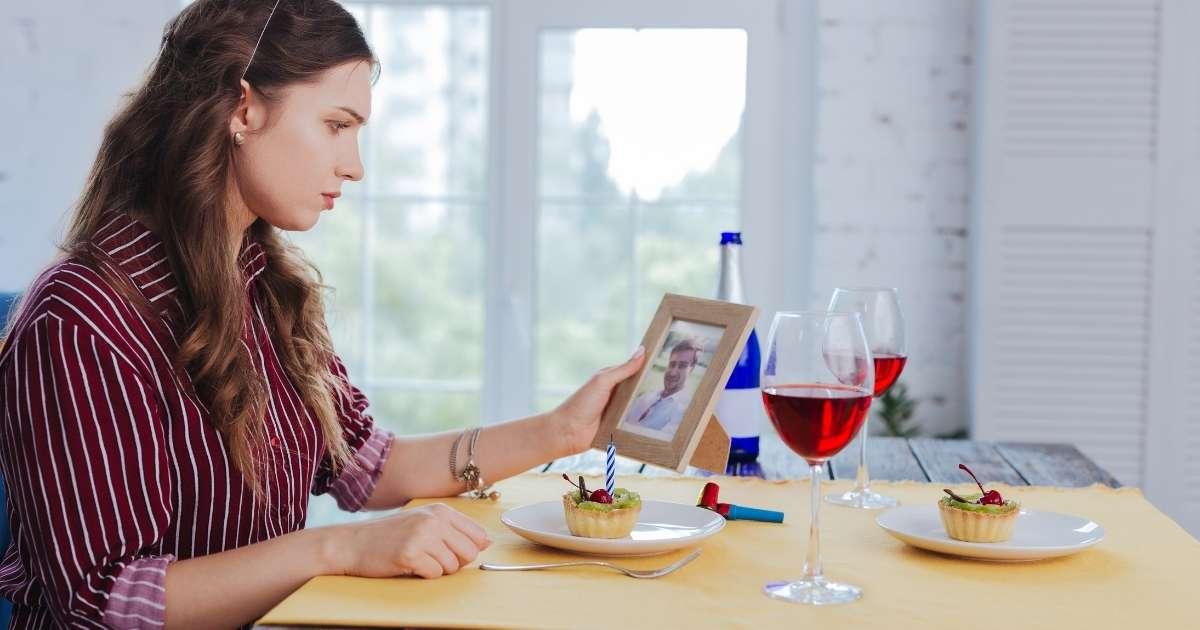 Woman look at ex-boyfriend photo