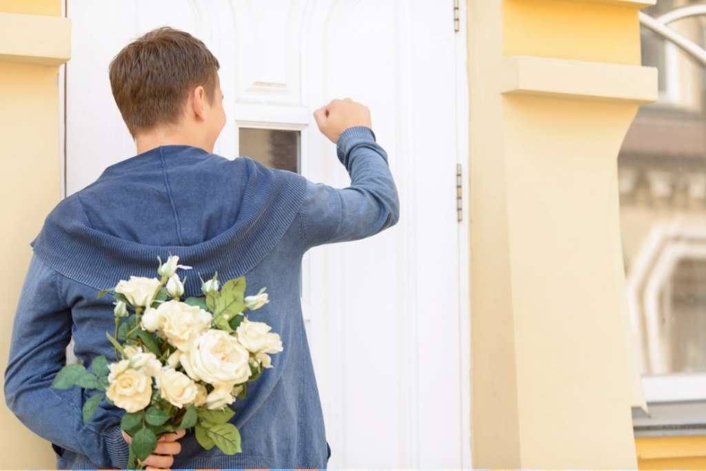Young Guy holding bouquet of flowers