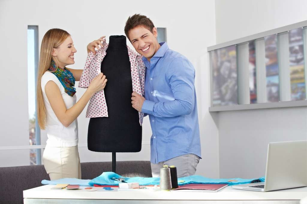 Happy man and woman in a dress studio